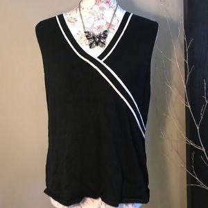 Black and white sweater vest 🧚🏻♀️
